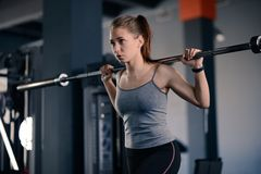 Attractive Young Sports Woman Doing Lunges with Barbell in the Gym. Fitness and Healthy Lifestyle. royalty free stock photos