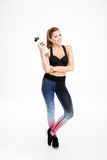 Attractive young sportswoman holding a bottle of water Royalty Free Stock Photography