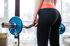Attractive young sportswoman training with barbell in gym Royalty Free Stock Photography