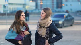 Attractive young student glamorous ladies gossiping, talking and laughing on the street, Steady cam, slow mo shot. Attractive young student glamorous ladies stock video footage
