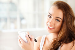 Attractive young student planning ahead Stock Images