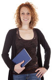 Attractive young student with textbook. Portrait of an attractive young student with textbook on white background Royalty Free Stock Photos