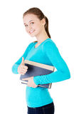 Attractive young student woman with book gesturing OK Royalty Free Stock Image