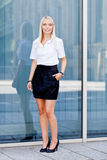 Attractive young successful smiling business woman standing outdoor Royalty Free Stock Image