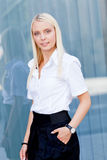 Attractive young successful smiling business woman standing outdoor Royalty Free Stock Photos