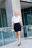 Attractive young successful smiling business woman standing outdoor Stock Photo