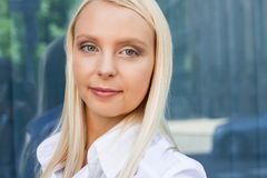 Attractive young successful smiling business woman standing outdoor Royalty Free Stock Images