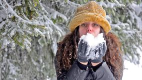 Attractive Young Teen Blowing Snow Flakes At Camera stock video footage
