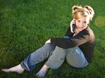 Attractive young teen talking on the phone Royalty Free Stock Photography