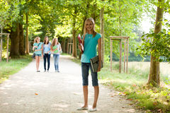 Attractive young teenage girl on her way to class Stock Photography