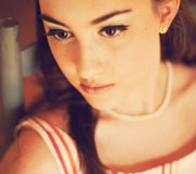 Attractive young teenager. Portrait of attractive female teenager with vintage feel royalty free stock photography