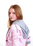 Attractive young teenager. Attractive young woman with long auburn hair looking over shoulder; white studio background Stock Image