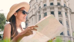 Attractive Young Tourist Girl with City Map Look Around. 4K, Slow Motion. Attractive Young Tourist Girl with City Map Look Around. 4K, Slow Motion stock video