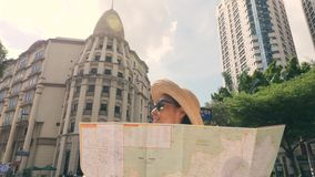 Young Tourist Girl with City Map Look Around. 4K, Slow Motion. Attractive Young Tourist Girl with City Map Look Around. 4K, Slow Motion stock video