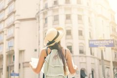 Attractive Young Tourist Girl Standing on Old Street with City Map and Look Around. stock images