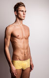 Attractive young undressed man model. Royalty Free Stock Image
