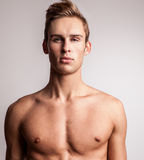 Attractive young undressed man model. Royalty Free Stock Photography