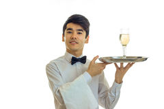 Attractive young waiter raised my head up and holding a tray with glasses of champagne Stock Photography