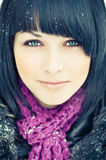 Attractive young woman. Portrait of attractive young woman with black hair; winter nature background Stock Photography