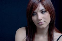 Attractive Young Woman. Against black background Royalty Free Stock Image