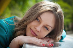 Attractive young woman. Lies on her hand Royalty Free Stock Photo