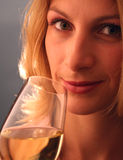 Attractive young woman. Woman drinking wine Royalty Free Stock Photography