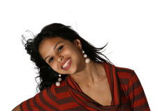 Attractive young woman. Attractive young Hispanic woman in a striped dress stock photos