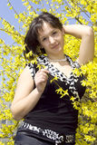 Attractive young woman. In flowering bush a spring day Stock Photos