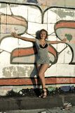 Attractive young woman against a wall of graffiti Stock Image