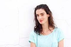Attractive young woman against white wall Royalty Free Stock Photo