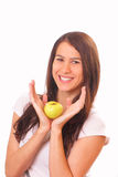 Attractive young woman with an apple Stock Images