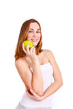 Attractive young woman with an apple Stock Image