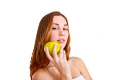 Attractive young woman with an apple Royalty Free Stock Photography