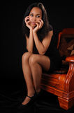 Attractive young woman in armchair Royalty Free Stock Photography