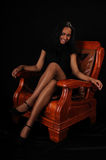 Attractive young woman in armchair royalty free stock photo