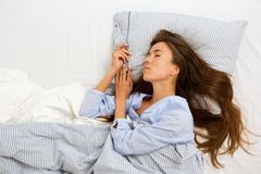 Attractive young woman asleep in bed Royalty Free Stock Image