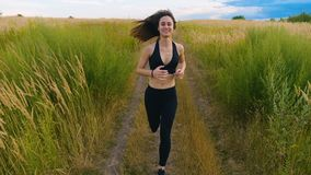 Attractive young woman athlete running in country jogging exercising enjoying healthy fitness lifestyle female runner on stock video