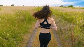 Attractive young woman athlete running in country jogging exercising enjoying healthy fitness lifestyle female runner on stock footage