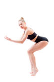 Attractive young woman athletic flexible girl in black suit looking at camera on white background Stock Photo