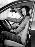 Attractive young woman in automobile Stock Image