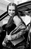 Attractive young woman in automobile Stock Photo