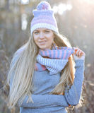 Attractive young woman in autumn fashion shot wearing cap, a gre Stock Images
