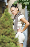 Attractive young woman in autumnal city Royalty Free Stock Photography