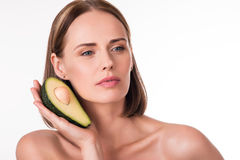 Attractive young woman with avocado Royalty Free Stock Image