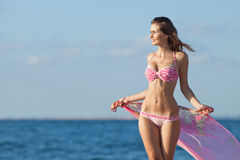 Attractive young woman on background of sea Stock Image