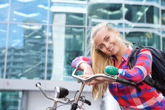 Attractive young woman with backpack and bike Stock Image