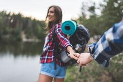 attractive young woman with backpack guiding boyfriend royalty free stock photo