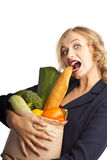Attractive young woman with a bag of food Stock Images