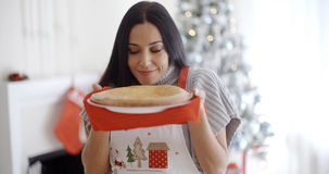 Attractive young woman baking tarts for Xmas Stock Photography