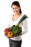 Attractive young woman with basket of vegetables Royalty Free Stock Photo